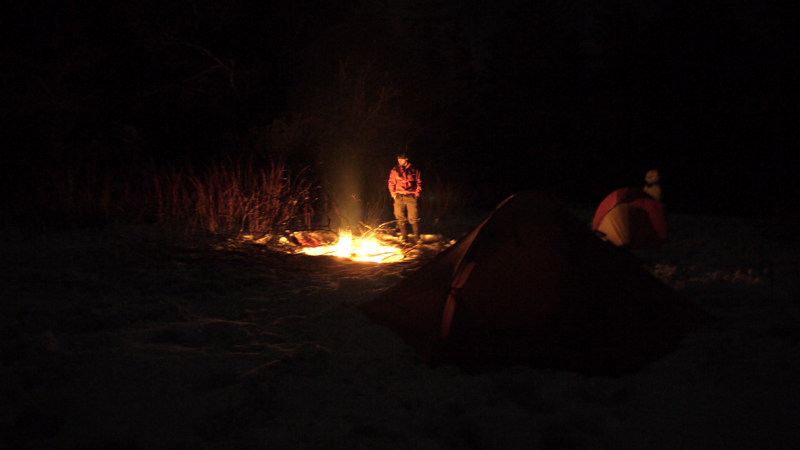 hiker by a fire