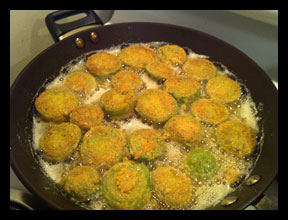 breaded green tomatoes frying
