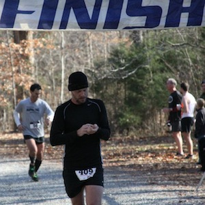 crossing the finish line at the Run at the Rock