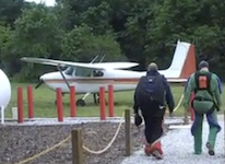 two guys walking to a plane