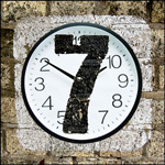 clock with a 7 on top of it