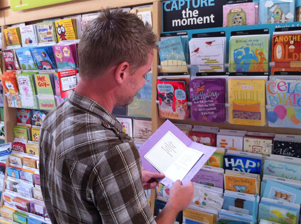 Guy looking at greeting card