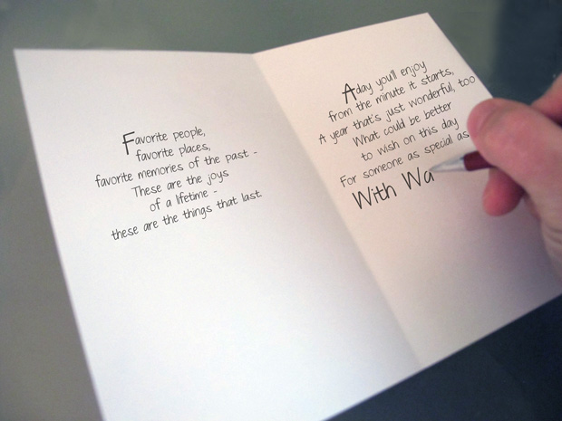 writing in a blank greeting card