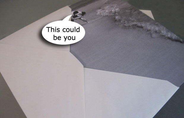 card sliding into an envelope