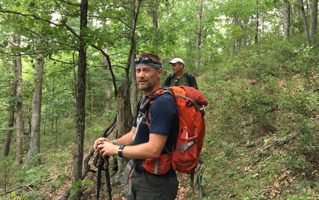 two hikers pause on the trail