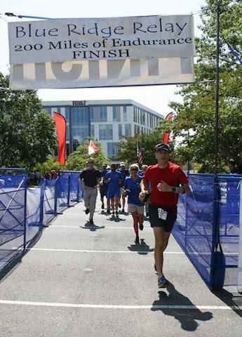 man finishing race