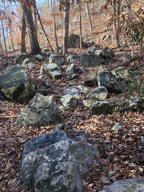 bunch of rocks on the side of a mountain