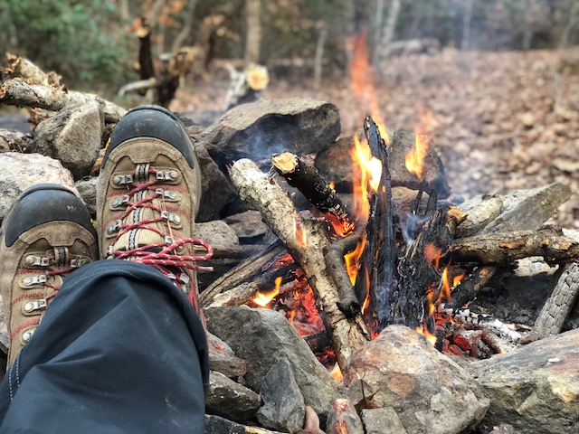 boots by a campfire
